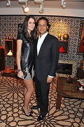 ARUN NAYAR and KIM JOHNSON at the Inspiring Morocco launch held at Harrods, Knightsbridge, London on 3rd November 2011.