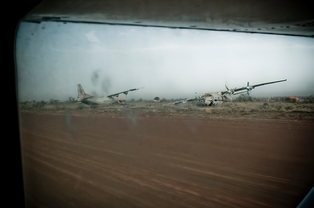 Wrecked aircraft litter the runway in the Southern Sudanese town of Wau. Sudan recently voted on whether or not to remain with the North or to set out alone as the world's newest nation. (© William B. Plowman)
