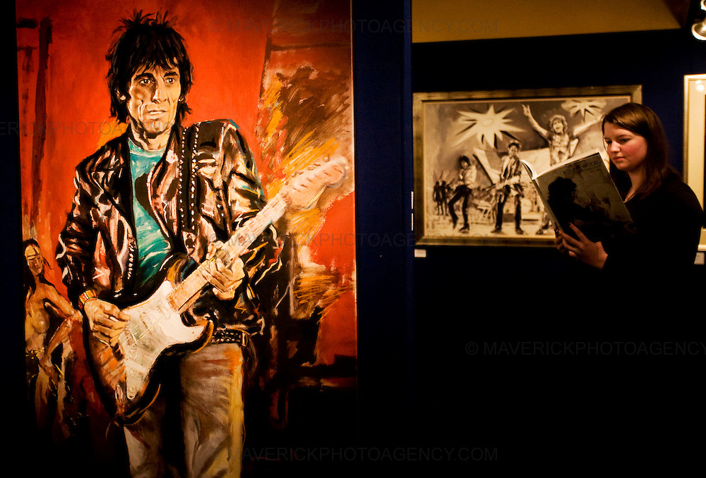 "Gallery assistant Slaine O'Halloran previews the Ronnie Wood print collection 1984-2003 exhibition at the Dome in Edinburgh..Picture is titled ""Wa Wa Wood""..27/1/2009.Picture Michael Hughes/Maverick"