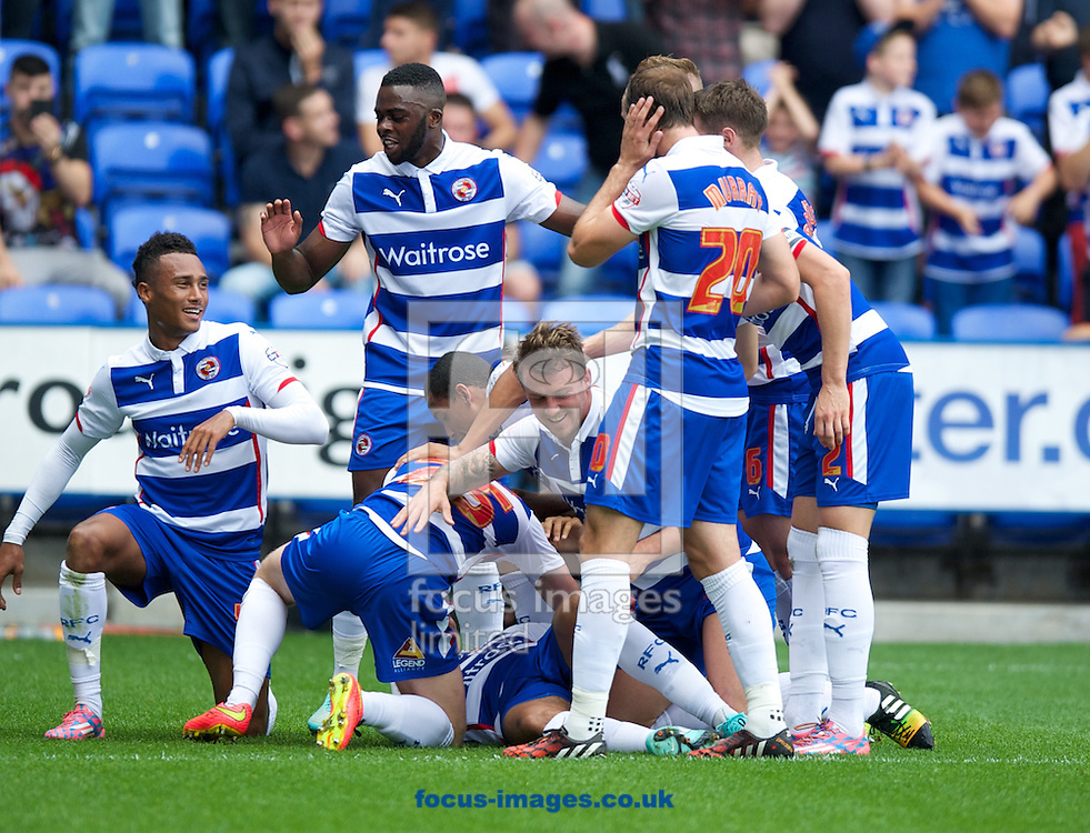 Reading players celebrate their first goal during the Sky Bet Championship match at the Madejski Stadium, Reading<br /> Picture by Alan Stanford/Focus Images Ltd +44 7915 056117<br /> 28/09/2014
