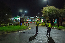 © Licensed to London News Pictures. 18/01/2020. Milton Keynes, UK. Police maintain a cordon at a entrance to the motorway services. Police and Search & Rescue volunteers are searching a motorway services and surrounding area after 6-year-old Aadil Umair Rahim went missing from the Newport Pagnell Services just off the M1 motorway at around 19:15 GMT. Photo credit: Peter Manning/LNP