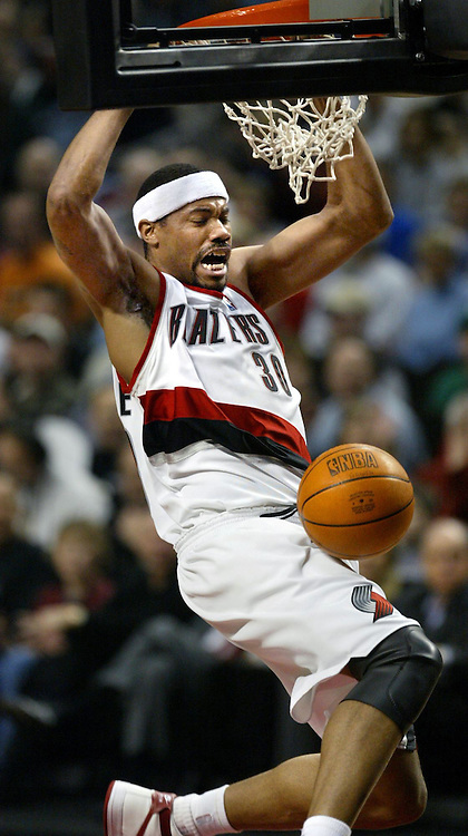 The Blazers' Rasheed Wallace (30) throws down a dunk in a run which gave the team back the lead. The Celtics beat the Blazers 100-92.