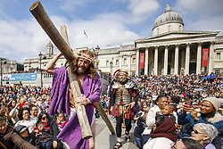 April 14, 2017 - London - Actors of the Wintershall Players perform 'The Passion of Jesus' on Good Friday to crowds in Trafalgar Square, London. The Wintershall Players are based on the Wintershall Estate in Surrey and perform several biblical theatrical productions per year. Their production of 'The Passion of Jesus' includes a cast of 80 actors, horses, a donkey and authentic costumes of Roman soldiers in the 12th Legion of the Roman Army. (Credit Image: © Tolga Akmen/London News Pictures via ZUMA Wire)