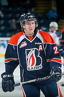 KELOWNA, CANADA - DECEMBER 17: Cole Ully #21 of Kamloops Blazers takes a shot on net during warm up against the Kelowna Rocketson December 27, 2014 at Prospera Place in Kelowna, British Columbia, Canada.  (Photo by Marissa Baecker/Shoot the Breeze)  *** Local Caption *** Cole Ully;