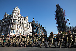 "© Licensed to London News Pictures. 10/10/2018. London, UK. 120 army personnel march through Parliament Square, led by the Band of the Grenadier Guards, to a ""welcome home"" reception in the Palace of Westminster, to highlight the breadth of the British Army's current activities. Photo credit : Tom Nicholson/LNP"