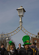 People in leprechaunt hats on Hapenny Bridge, Dublin, St. Patrick's Day, 2009