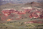 See red hills from Blue Basin Overlook Trail, Sheep Rock Unit, John Day Fossil Beds National Monument, Oregon, USA. John Day Fossil Beds preserves layers of fossil plants and mammals that lived between the late Eocene, about 45 million years ago, and the late Miocene, about 5 million years ago.