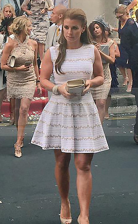 © Licensed to London News Pictures. 16/06/2015. London, UK. Colleen Rooney leaves after attending what is believed to be the wedding of Manchester United footballer Tom Cleverly and his fiancé Georgina Dorsett Photo credit : Alfonso Camacho/LNP