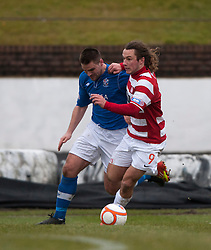 Cowdenbeath's John Armstrong and Hamilton's Steven May..half time : Cowdenbeath v Hamilton, 9/3/2013..©Michael Schofield..