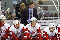 November 30, 2010; San Jose, CA, USA;  Detroit Red Wings head coach Mike Babcock stands behind his team on the bench during the first period against the San Jose Sharks at HP Pavilion. Mandatory Credit: Jason O. Watson / US PRESSWIRE