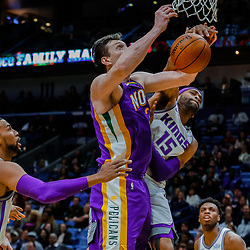 Jan 30, 2018; New Orleans, LA, USA; Sacramento Kings guard Vince Carter (15) fouls New Orleans Pelicans center Omer Asik (3) during the fourth quarter at the Smoothie King Center. The Kings defeated the Pelicans 114-103. Mandatory Credit: Derick E. Hingle-USA TODAY Sports