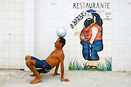 "Portuguese Summer. A man plays with his ball near the known restaurant ""O Barbas""  at the Costa da Caparica beach."