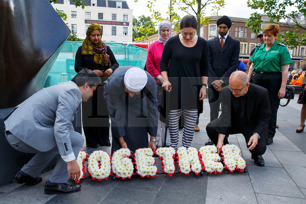 © Licensed to London News Pictures. 06/07/2015. London, UK. 7/7 survivor Gill Hicks laying a wreath at King's Cross Square with faith leaders Rabbi Laura Janner-Klausner, Imam Qari Asim and Revd Bertrand Olivier to commemorate the 10th anniversary of 7/7 bombings by remembering those who lost their lives, as well as offering a message of peace and unity between people of different faiths and backgrounds. Photo credit: Tolga Akmen/LNP