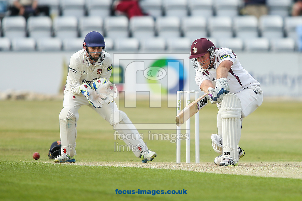 Richard Levi of Northamptonshire (right) reaches for the ball during the LV County Championship Div Two match at the County Ground, Northampton<br /> Picture by Andy Kearns/Focus Images Ltd 0781 864 4264<br /> 08/06/2015