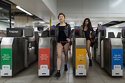 """© Licensed to London News Pictures. 13/01/2019. LONDON, UK.  Participants take part in """"No Trousers On The Tube Day"""".  Now in its 10th year, the annual event sees hundreds of riders travel on the tube without wearing trousers.  Similar rides are taking place worldwide under the umbrella of """"No Pants Subway Ride"""", which launched in New York in 2002.  Photo credit: Stephen Chung/LNP"""