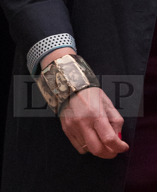 © Licensed to London News Pictures. 16/10/2017. London, UK. Prime Minister Theresa May leaves Downing Street for Brussels wearing a bracelet decorated with paintings. Later Mrs May and Brexit Secretary David Davis will have dinner with EU chief negotiator Michel Barnier and Commission chief Jean-Claude Juncker in Brussels after Brexit talks were described as being in deadlock. Photo credit: Peter Macdiarmid/LNP