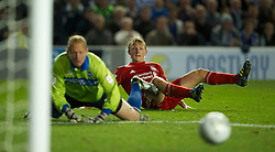 BRIGHTON, ENGLAND - Wednesday, September 21, 2011: Liverpool's Dirk Kuyt scores the second goal as Brighton & Hove Albion's goalkeeper Casper Ankergren looks on during the Football League Cup 3rd Round match at the Amex Stadium. (Pic by David Rawcliffe/Propaganda)
