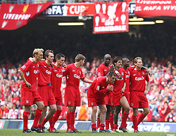 CARDIFF, WALES - SATURDAY, MAY 13th, 2006: Liverpool's players Momo Sissoko and Jamie Carragher pray as their team-mates watch West Ham United take a penalty during the shoot-out at the FA Cup Final at the Millennium Stadium. (Pic by David Rawcliffe/Propaganda)