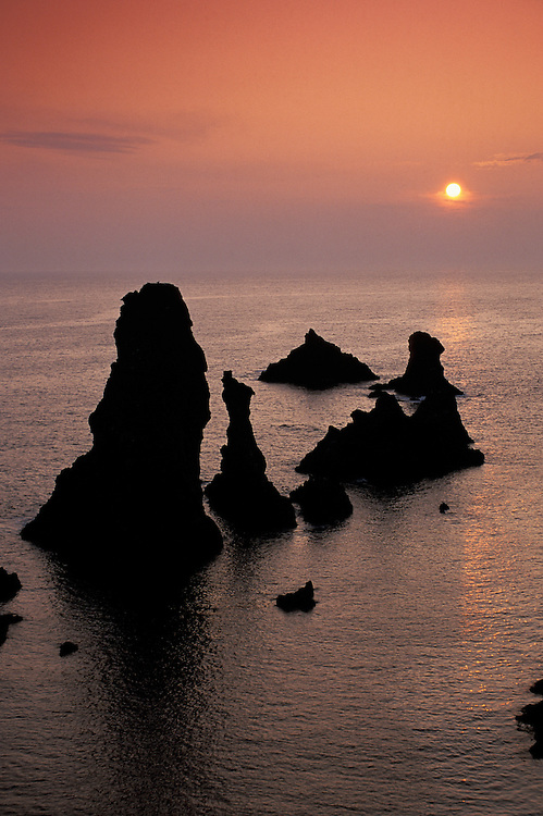 Sunset over Sea stacks,Aiguilles de Port Coton,Belle Ile,Bretagne,France