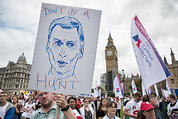 © Licensed to London News Pictures. 06/09/2017. London, UK. A nurse holds a placard mocking Health Secretary Jeremy Hunt during a demonstration in Parliament Square. The Royal College of Nursing is campaigning against the Government's one per cent cap on public sector pay. Photo credit: Peter Macdiarmid/LNP