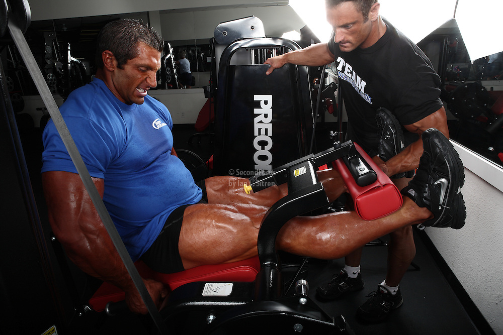 Bodybuilders Dan Decker and Brian Yersky doing leg extensions.