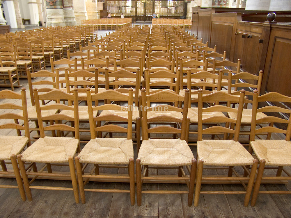 old style chairs lined up in an church St. Bavo Holland