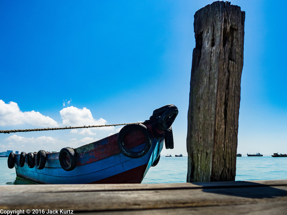 15 NOVEMBER 2016 - GEORGE TOWN, PENANG, MALAYSIA:  A boat tied up at the Chew Jetty, one of the traditional Chinese clan jetties in George Town, Penang. George Town is a UNESCO World Heritage city and wrestles with maintaining its traditional lifestyle and mass tourism.           PHOTO BY JACK KURTZ