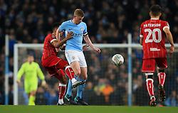 Korey Smith of Bristol City tackles Kevin De Bruyne of Manchester City - Mandatory by-line: Matt McNulty/JMP - 09/01/2018 - FOOTBALL - Etihad Stadium - Manchester, England - Manchester City v Bristol City - Carabao Cup Semi-Final First Leg