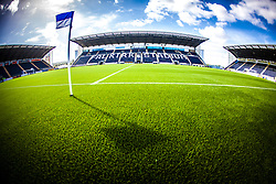Picture from the half-way line showing the three stands and the new plastic pitch, at The Falkirk Stadium, for the Scottish Championship game v Hamilton. The woven GreenFields MX synthetic turf and the surface has been specifically designed for football with 50mm tufts compared with the longer 65mm which has been used for mixed football and rugby uses.  It is fully FFA two star compliant and conforms to rules laid out by the SPL and SFL.<br />