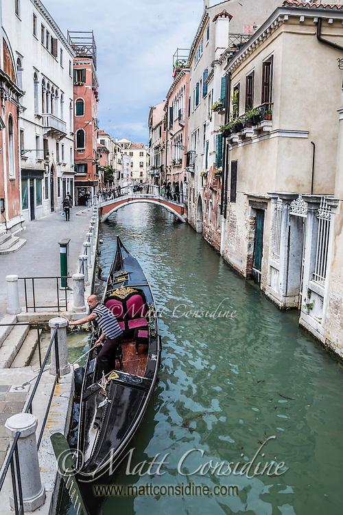 An iconic scene of a gondolier docking in Venice. (Photo by Travel Photographer Matt Considine)