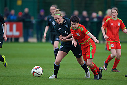 NEWPORT, WALES - Friday, April 1, 2016: Wales' Emily Jones in action against the Republic of Ireland's Meghen Hengerer during Day 1 of the Bob Docherty International Tournament 2016 at Dragon Park. (Pic by David Rawcliffe/Propaganda)