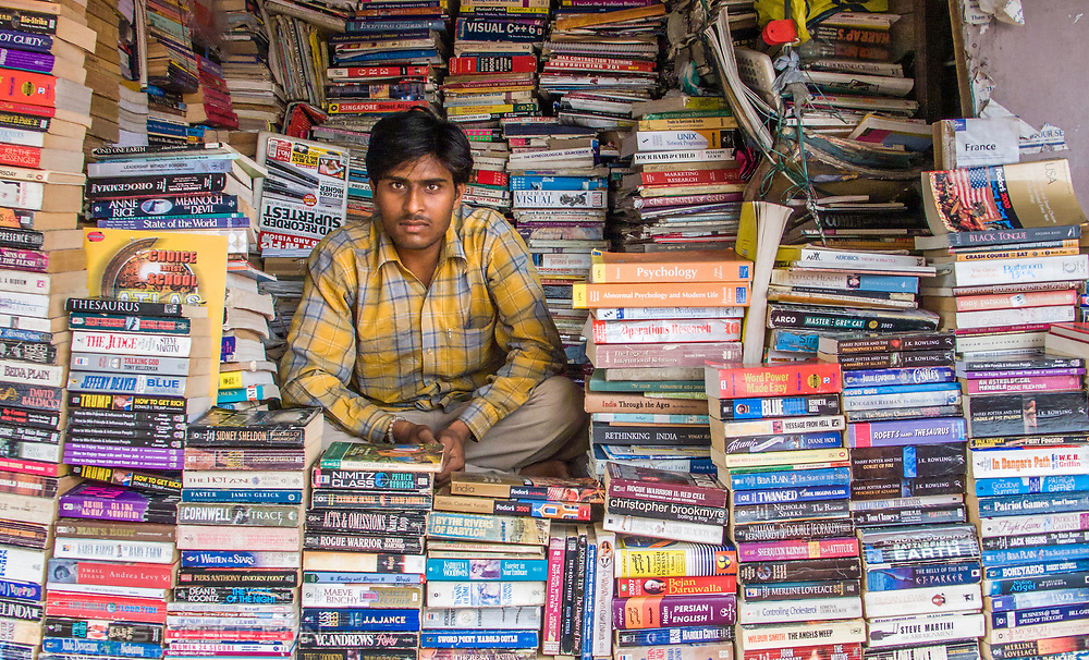 Second-hand book stall, New Delhi, India.<br /> Picture date: Saturday September 15, 2007.<br /> Photograph by Christopher Ison &copy;<br /> 07544044177<br /> chris@christopherison.com<br /> www.christopherison.com