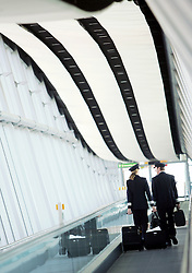 Gatwick Airport, North Terminal, airside, pilots walking on travelator in Pier 6 passenger bridge, March 2006, Ref CGA01254d, DP