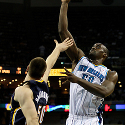 April 3, 2011; New Orleans, LA, USA; New Orleans Hornets center Emeka Okafor (50) shoots over Indiana Pacers power forward Tyler Hansbrough (50) during the first quarter at the New Orleans Arena.    Mandatory Credit: Derick E. Hingle