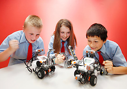 No fee for Repro: 20/06/2012.?Getting Robotic?.Derek Browne, Lucy Hiseman and David Oleman of St Philips School, Mountview Dublin just three of the 90 young students to complete their ten day programme at the ITB (Institute of Technology Blanchardstown) Robotics Summer School.  Pic Andres Poveda.