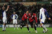 Photo: Paul Thomas.<br /> Blackburn Rovers v Manchester United. The Barclays Premiership. 11/11/2006.<br /> <br /> Cristiano Ronaldo and Louis Saha celebrate his goal, while Blackburn are dejected.