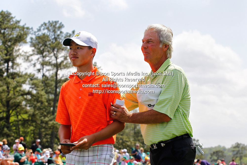 AUGUSTA, April 13, 2013  China's Guan Tianlang (L) is congratulated by Masters champion Ben Crenshaw on the 18th hole during the second round of the 2013 Masters golf tournament at the Augusta National Golf Club in Augusta, Georgia, the United States, April 12, 2013. Guan shot a three-over par 75 Friday and stood at four-over 148 after 36 holes.