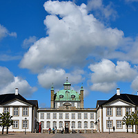 Expansion History of Fredensborg Palace in Fredensborg, Denmark<br /> When the initial pleasure palace for King Frederick IV was finished in 1726, it was a modest building of one-and-a-half stories. His successor, King Christian VI, initiated a significant expansion in 1741 that would stretch through the reigns of two more Danish kings.  By 1770, it had evolved into an elaborate, octagonal-shaped complex complete with riding stables and a huge garden.  It became a favorite venue for monarchs to spend their holidays plus their spring and summer months.