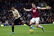 Manchester United forward Anthony Martial (9) and Burnley defender James Tarkowski 5) during the Premier League match between Burnley and Manchester United at Turf Moor, Burnley, England on 28 December 2019.