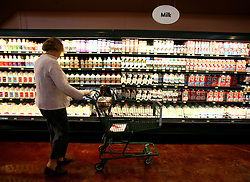01 Feb 2006. Uptown, New Orleans, Louisiana.  Post Katrina. <br /> The Whole Foods supermarket reopens amidst great celebration 5 months after  the city was hit by Hurricane Katrina. A customer  stops in the dairy department.<br /> Photo; Charlie Varley/varleypix.com