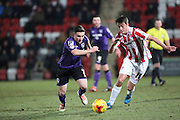 Jack Redshaw comes away with the ball for Morecambe during the Sky Bet League 2 match between Cheltenham Town and Morecambe at Whaddon Road, Cheltenham, England on 16 January 2015. Photo by Shane Healey.