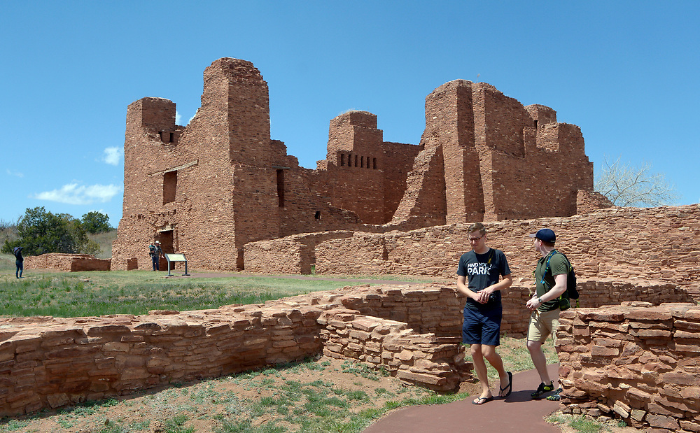 gbs041217j/STATE -- Mikah Meyer of Lincoln, Nebraska, left, and Tim Logan of Vancouver, Canada walk through ruins of the Quarai mission church and pueblo on Wednesday, April 12, 2017. Meyer is on a quest to visit all of the 415+ U.S. National Park Service sited in one continuous journey. (Greg Sorber/Albuquerque Journal)