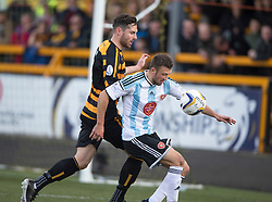 Alloa Athletic's Ben Gordon and Hearts Dale Carrick.<br /> half time : Alloa Athletic 0 v 0 Hearts, Scottish Championship played at Recreation Park, Alloa.