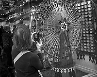 Woman taking an image of the Sardine Lottery. Library. mage taken with a Leica CL camera and 23 mm f/2 lens.