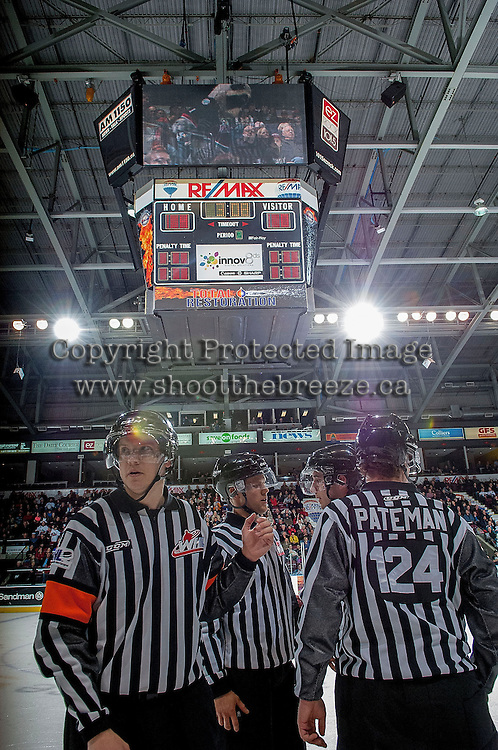 KELOWNA, CANADA -FEBRUARY 5: WHL officials, Mike Langin and Derek Zalaski, referees and Dustin Minty and Ward Pateman, linesmen, stand on the ice to discuss a questionable goal during the second period between the Kelowna Rockets and the Red Deer Rebels on February 5, 2014 at Prospera Place in Kelowna, British Columbia, Canada.   (Photo by Marissa Baecker/Getty Images)  *** Local Caption *** Mike Langin; Dustin Minty; Ward Pateman; Derek Zalaski; officials; referees; linesman;