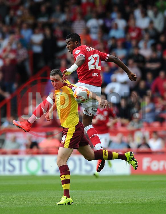 Jonathan Kodjia of Bristol City battles for the high ball with Michael Duff of Burnley  - Mandatory byline: Joe Meredith/JMP - 07966386802 - 29/08/2015 - FOOTBALL - Ashton Gate -Bristol,England - Bristol City v Burnley - Sky Bet Championship