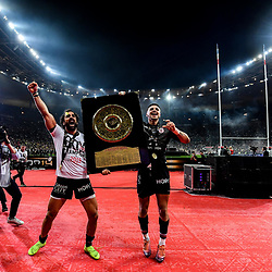 Yoann Huget and Romain Ntamack of Toulouse celebrates the victory with the trophy during the Top 14 Final match between Toulouse and Clermont at Stade de France on June 15, 2019 in Paris, France. (Photo by Anthony Dibon/Icon Sport)