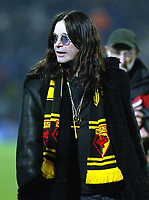 30/11/2004 - Watford v Portsmouth - Carling Cup - Quarter Final<br />Rockstar Ozzy Osbourne on the pitch at halftime wearing Watford scarf<br />Jed Leicester/Back Page Images