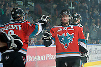 KELOWNA, CANADA, OCTOBER 26:  Shane McColgan #18 of the Kelowna Rockets takes part in a pre-game ritual as the Prince George Cougars visit the Kelowna Rockets  on October 26, 2011 at Prospera Place in Kelowna, British Columbia, Canada (Photo by Marissa Baecker/Shoot the Breeze) *** Local Caption *** Shane McColgan;