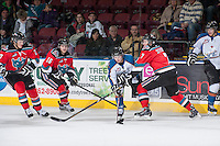 KELOWNA, CANADA - DECEMBER 7: Damon Severson #7 of the Kelowna Rockets checks Luke Philp #12 of the Kootenay Ice on December 7, 2013 at Prospera Place in Kelowna, British Columbia, Canada.   (Photo by Marissa Baecker/Shoot the Breeze)  ***  Local Caption  ***